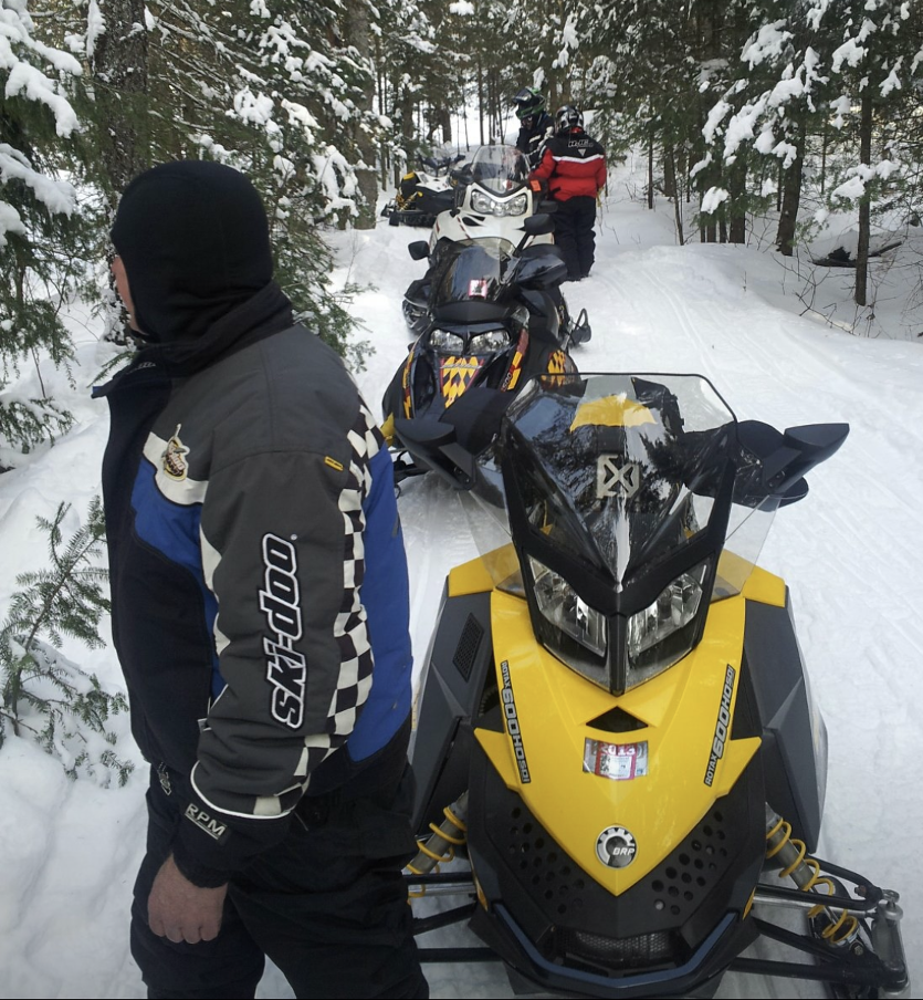 Couples Snowmobile Cruise in Ontario, CA| Ontario Snowcruises, LTD | Couple on a Trail